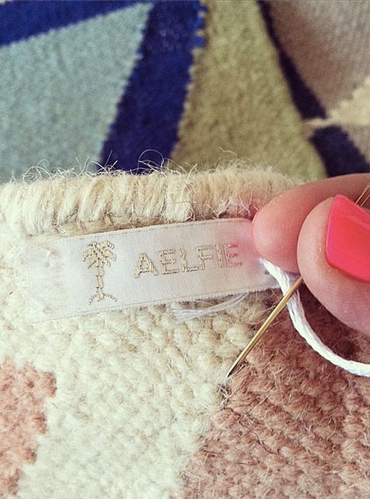In keeping with the handcrafted ethos, Aelfie labels are hand-sewn onto the rugs.
