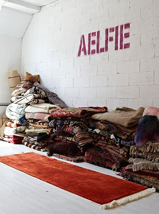 In Aelfie's Brooklyn studio, half of the space is piled with vintage and antique rugs, textiles, and pillows that she's gathered. Photo by Kristine Wood.