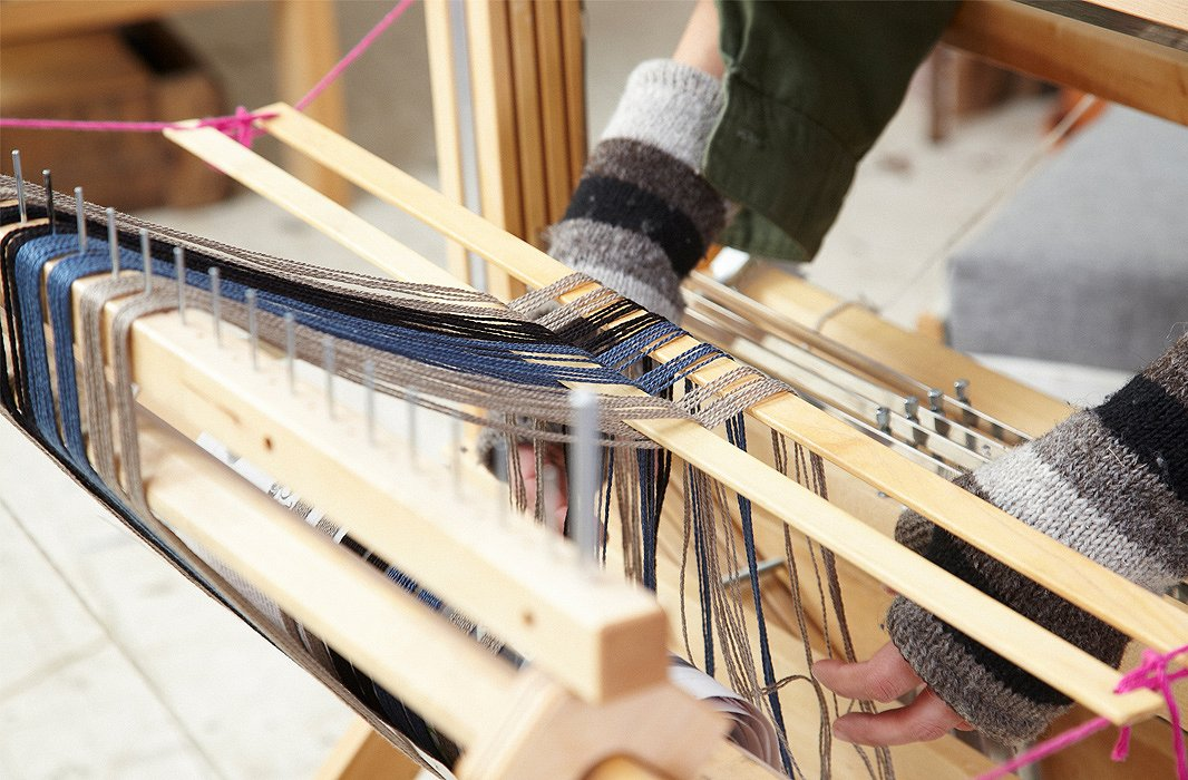 Dressing the loom takes Nadia about an hour before she's ready to start weaving.