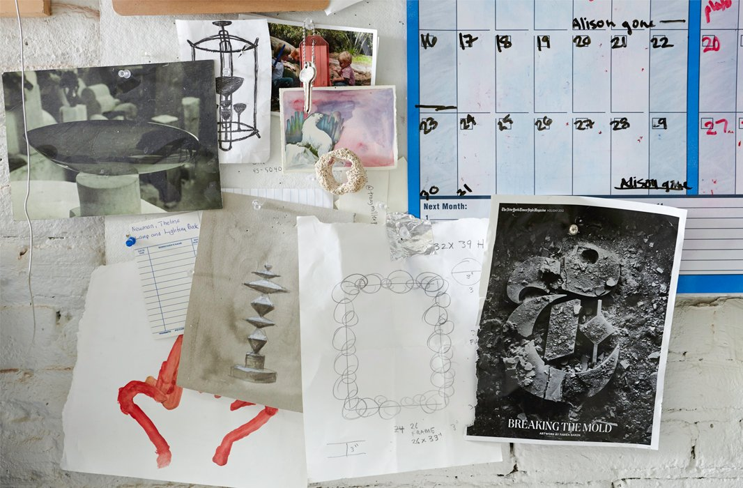 A calendar and bits of inspiration and sketches share wall space in the studio.
