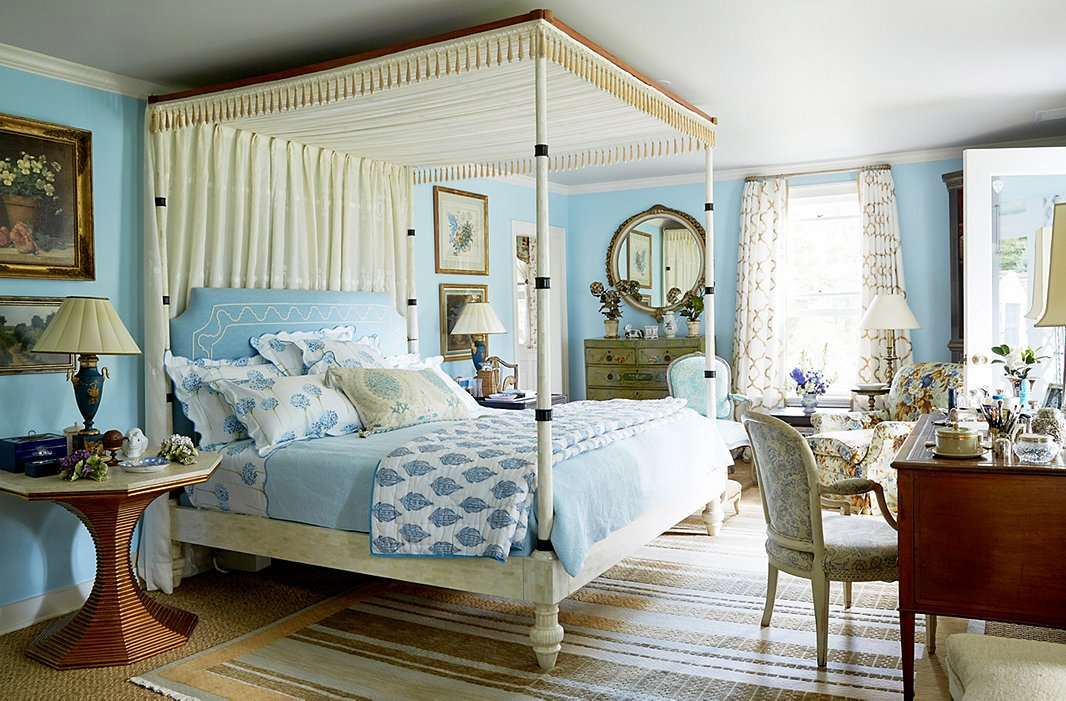 """It's heaven"" waking up in her pale turquoise bedroom, says Bunny. The bed, made of bone, was designed by John and built in his shop; the limestone-topped bedside table is from Bunny Williams Home."