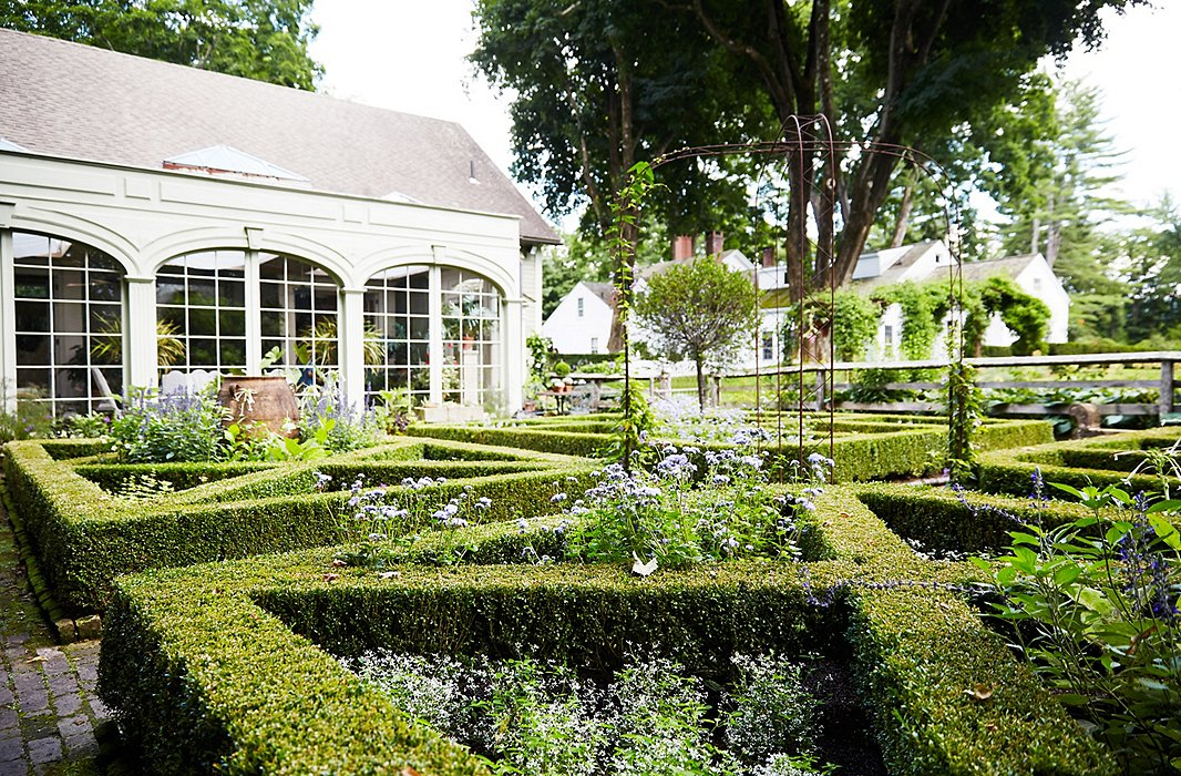 For the formal parterre gardens, visible from the conservatory where Bunny does much of her entertaining, part of the decision to create a box structure was the beautiful view it provided year-round, whether filled with annuals in the summer or covered with snow in the winter.