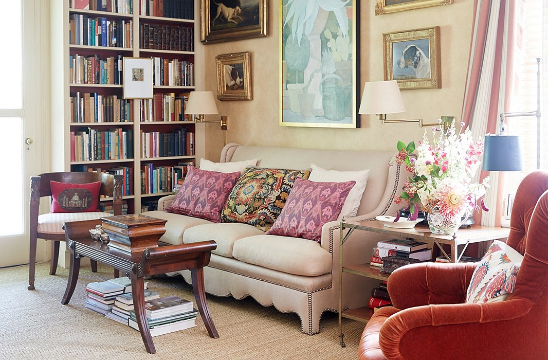 A warm palette and a wide range of textures and materials—linen, velvet, satin, sea grass, rough cotton, polished wood—create depth and interest in the library.