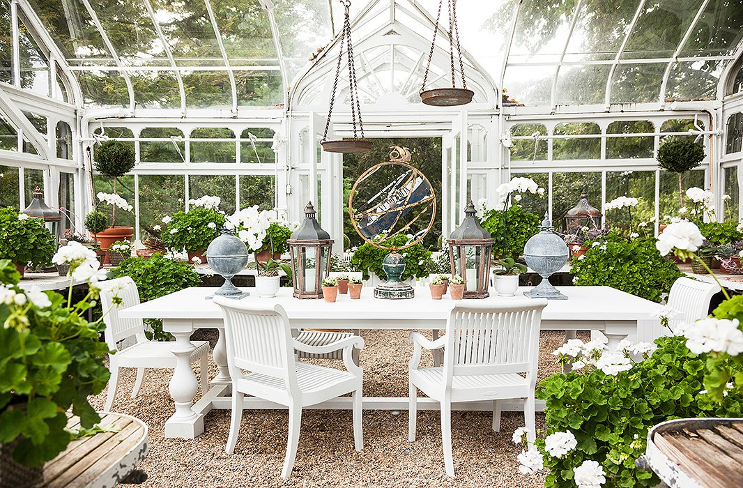 "Carolyne ""prettified this little glasshouse"" with lots of geraniums and a mix of metals."