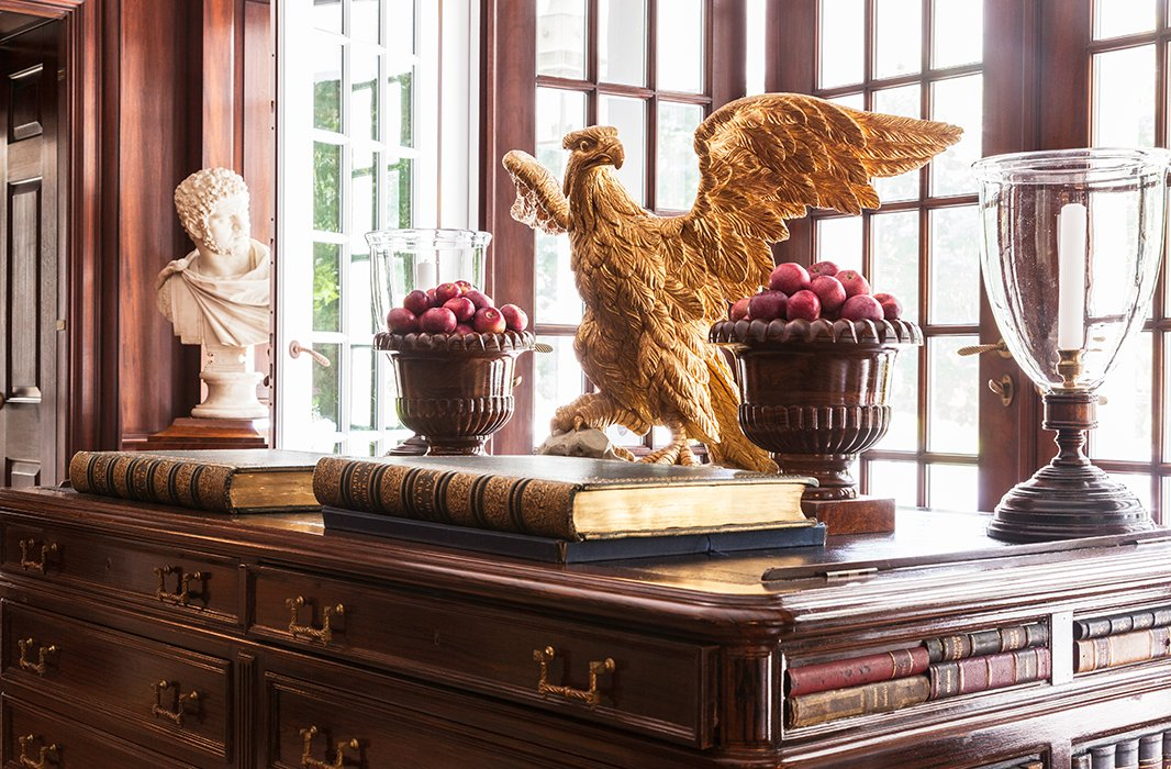 An English library desk is topped with leather, making it ideal for reading the antique books.