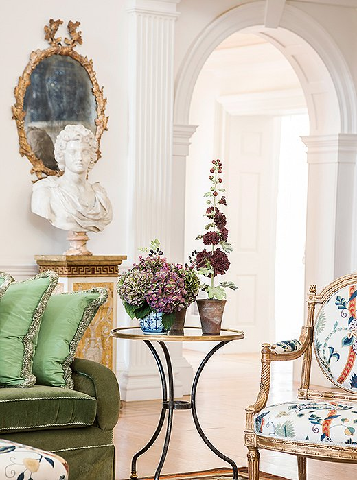Each room features a different tone of white on the walls, achieved by mixing up to four paints. Here, the white sets off the classical elements of a pilaster next to a gentle arch.