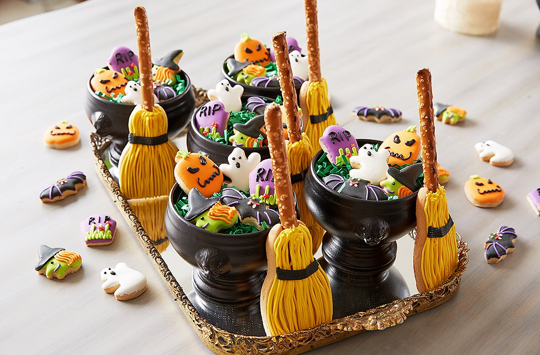"""I love our petite Halloween cookies with the tombstone, ghost, witch, bat, pumpkin, and broom,"" says Dylan, who lays them out on a gold-rimmed mirrored tray for an ornate touch that's in keeping with the theme. ""They make great favors, especially when placed in a mini cauldron."""