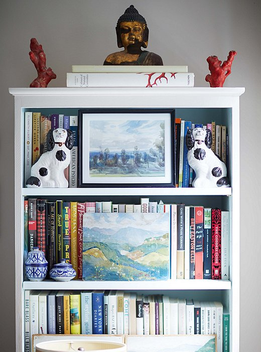 Placing art and collectibles in front of book spines can make a shelf look more cohesive (and can also obscure the titles of those guilty pleasures you might not want others to know you've read). Photo by Manuel Rodriguez.