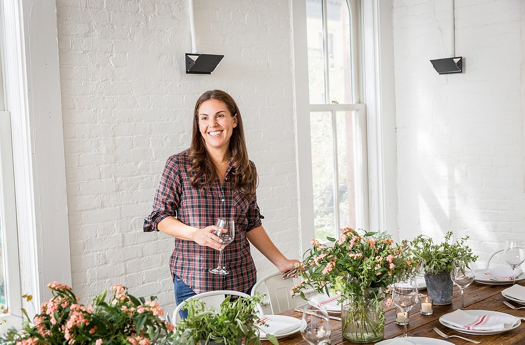 Alison has learned not to be actively cooking when her guests start to arrive—she might be fussing with the centerpieces or sprinkling herbs in a dish, but nothing that requires total focus.