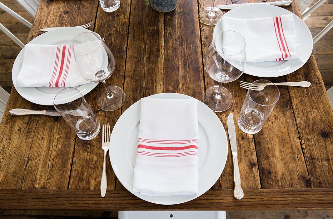 No need for a tablecloth, unless there's one you adore using—raw wood looks beautiful and sets off food perfectly.