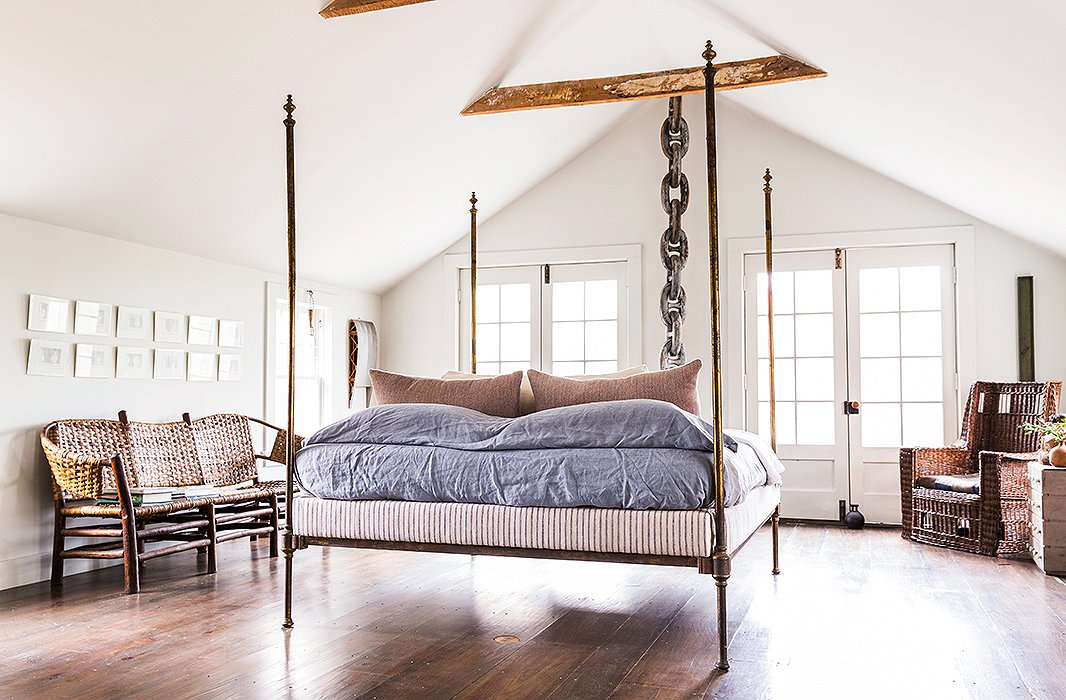 "The master bedroom is simultaneously quiet and packed with drama. As for bed linens, ""I think bedding should be very calm and serene and have nice textures rather than bold colors,"" says Huniford."