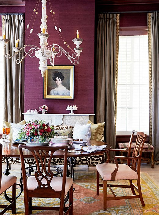 The wooden parquet de Versailles dining table features a decorative iron base. The chandelier was a lucky bargain find.