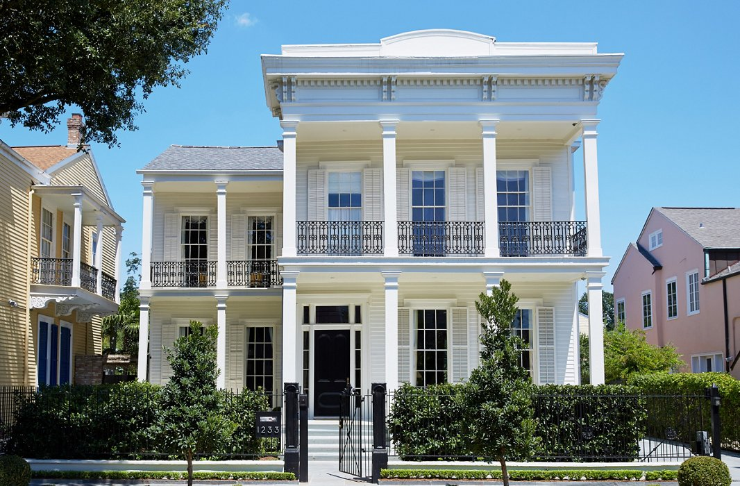 Stately columns, iron railings, and an all-white facade lend the 19th-century house a grand yet inviting stature. Jane Scott loves the community spirit of her Garden District neighborhood.