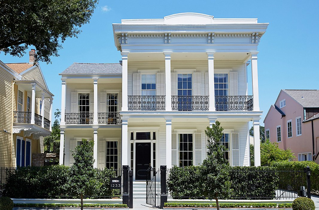Stately Columns Iron Railings And An All White Facade Lend The 19th