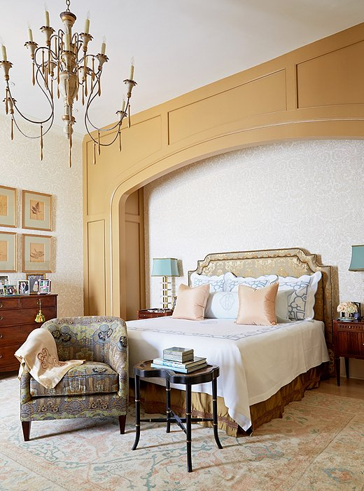 A graceful built-in nook adds architectural interest and gives the bed a grand presence.