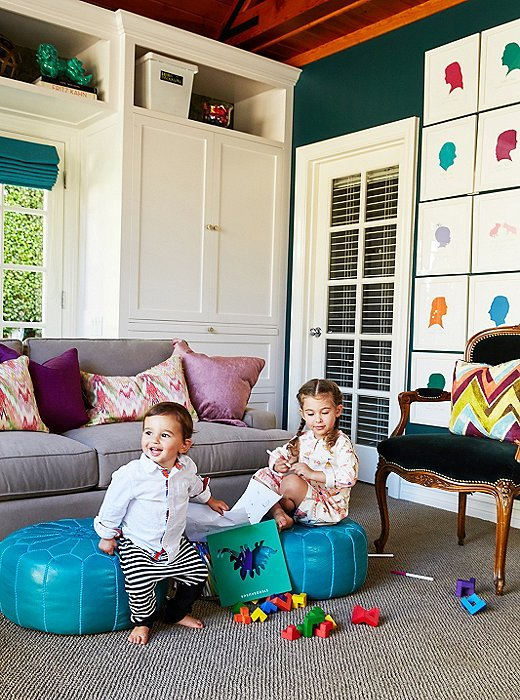The multiuse space is sophisticated yet child-friendly. It cleverly mixes and matches Middle Eastern touches—the poufs and ikat pillows—with classical European elegance, such asthis Louis XV-style chair.