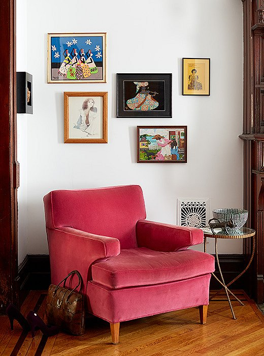 "Above a pink chair hang pictures of women: ""some working, some not, some modern, some older… all beautiful and confident, thoughtful and creative. I like what it says about us,"" Jodie explains."