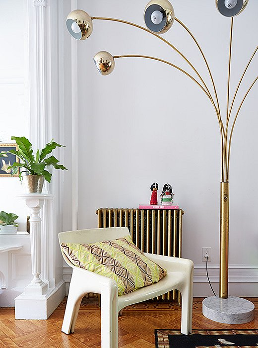 Rather than redo the heating system, Jodie had the exposed radiators painted gold.