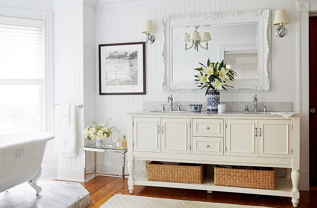 Awash in Carrara marble, the beadboard-walled master bath is a breezy departure from the rich tones and textures that define the rest of the house.