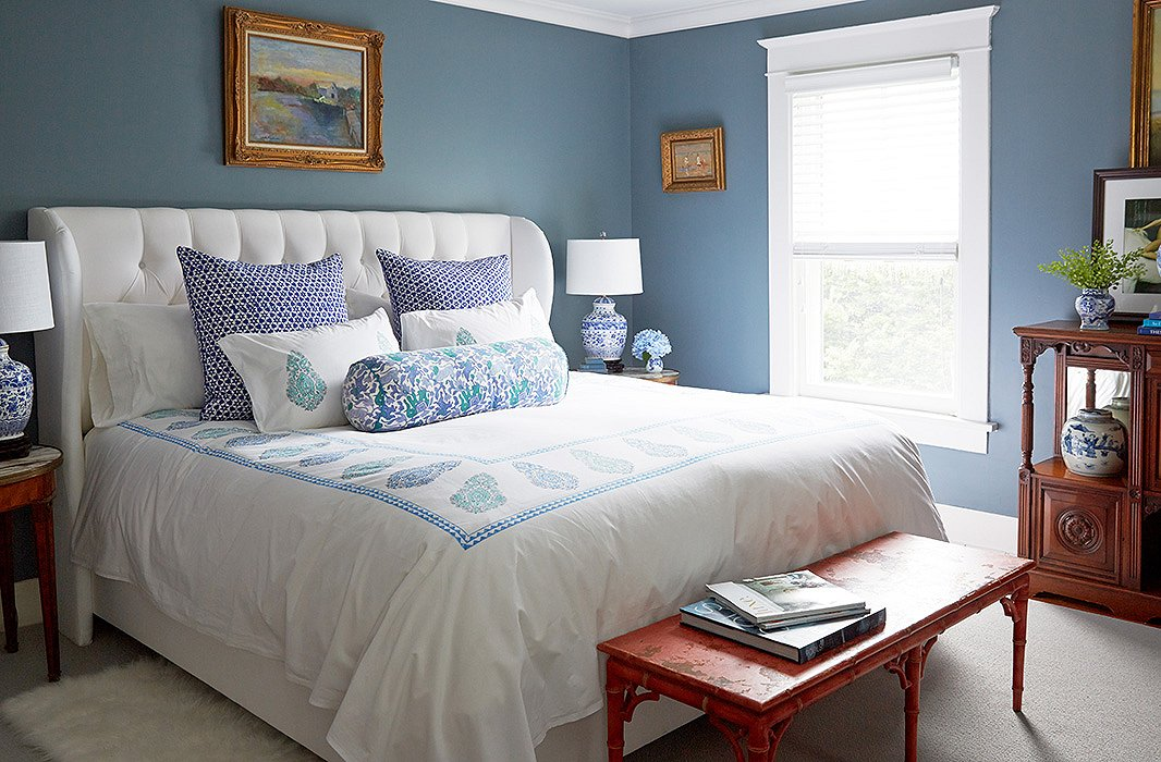 In the master bedroom a tufted bed from one kings lane is dressed in block