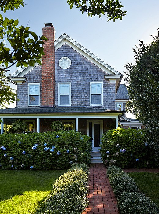 The circa-1885 Victorian farmhouse in the Hamptons town of Water Mill boasts a gracious mahogany porch characteristic of the era in which it was built.