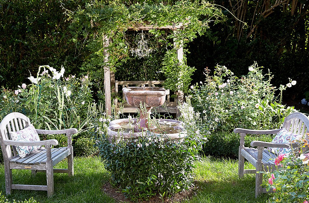 One corner of the grounds evokes the romanticism of a secret garden, from the antique limestone fountain shrouded with greenery to the trellis covered in a wild spray of climbing vines.