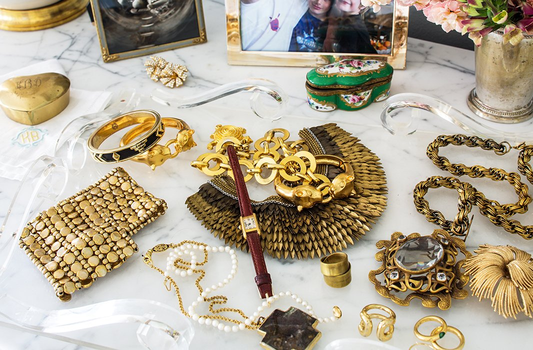 "Bachmann favors vintage jewelry. ""My style is not supergrand,"" she says. She'll often wear one big piece to amp up a simple outfit—be it one of her own dresses or a pair of jeans and a white button-down shirt."