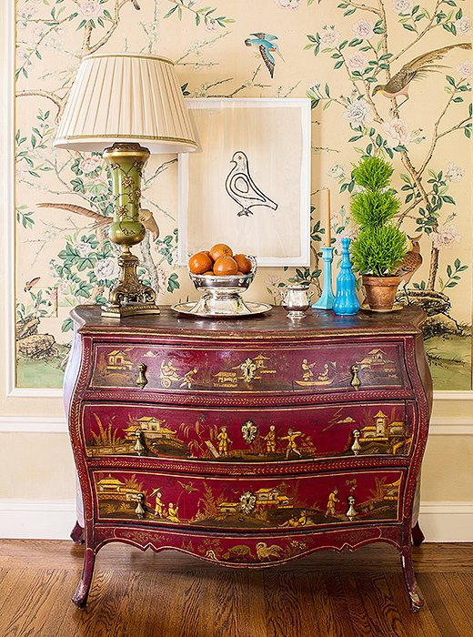 Bachmann's way with whimsical combinations is evident in her placement of a minimalist Hugo Guinness bird print above an ornate vintage chinoiserie chest.