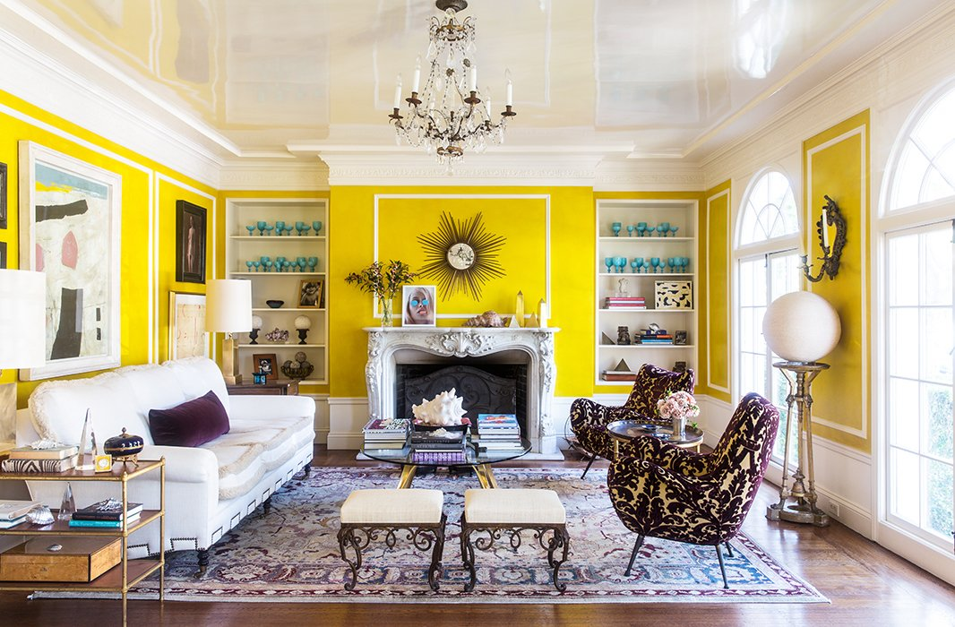 The eye-popping paint choice, coupled with the room's abundance of natural light, allowed Bachmann to use mostly neutral furnishings but still achieve a cheery effect.