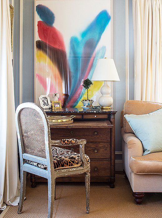 A leopard-print chair and the lovely watercolor Bachmann lucked upon at a secondhand store add interest to the soothing, sedate space.