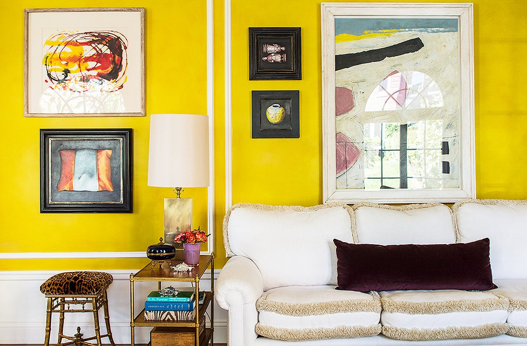 Bachmann's taste in artwork is all over the map, ensuring that her living spaces are anything but stuffy. Her mix-and-match approach to framing helps heighten the room's casually eclectic vibe.