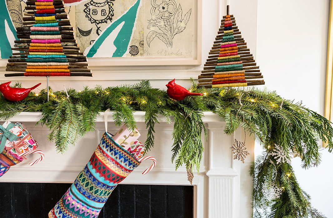 The handmade, organic feel of the twig trees Lilly used to decorate the mantel feel festive but not so refined that an ornament made by the kids couldn't hang nearby.