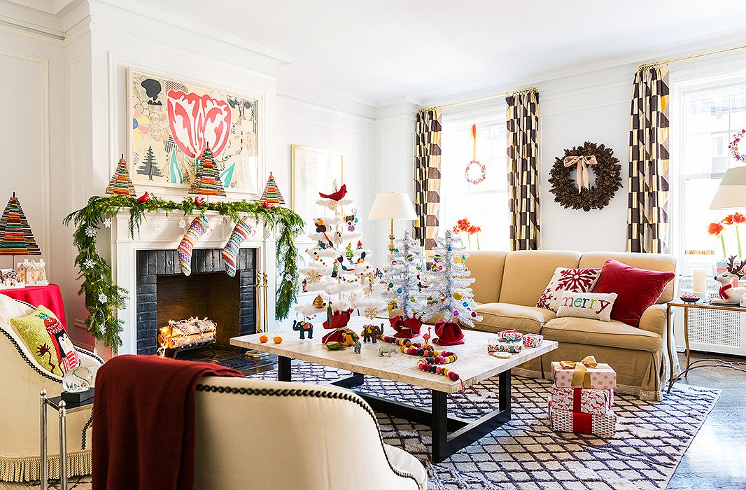 So many holiday elements are present, though even with the window wreaths, the mini twig trees, and the Christmas pillows, the room feels sophisticated, not kitschy.