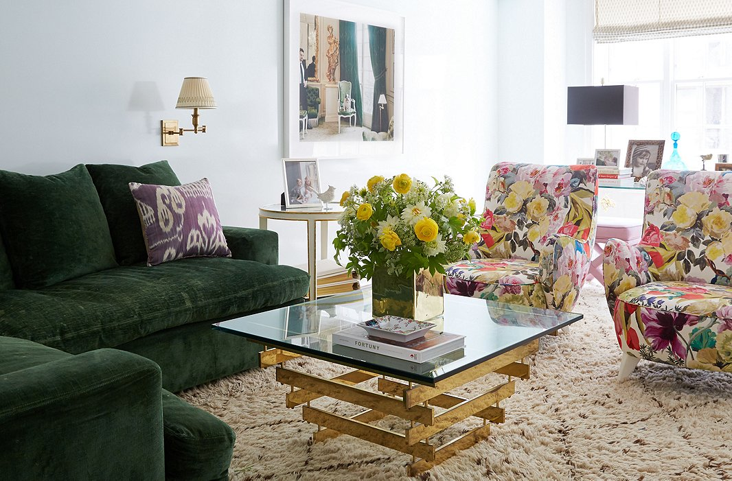 "Lilly upholstered a pair of Vladimir Kagan chairs in a print she calls ""a kind of contemporary chintz."" The Roman shades were created using a Fortuny print, which stays safely out of reach of little hands."