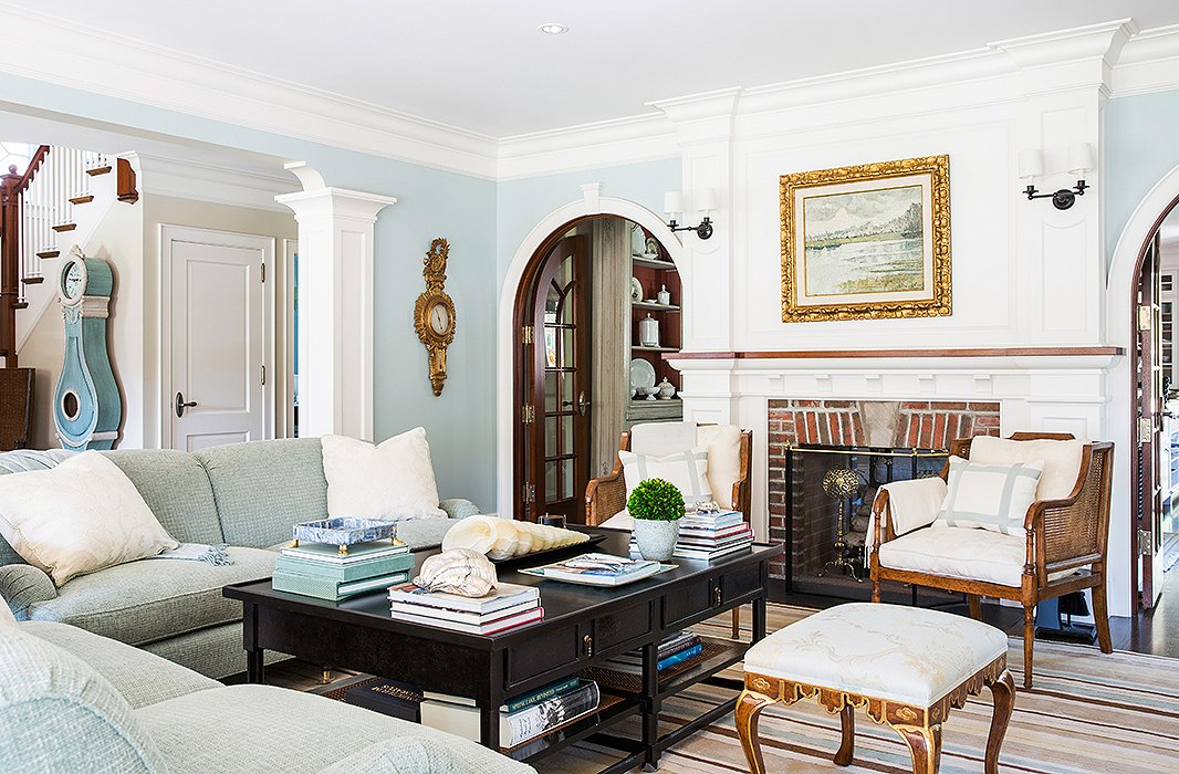 a clock standing in the entrance introduces the blue palette right off the bat - Neutral Living Room