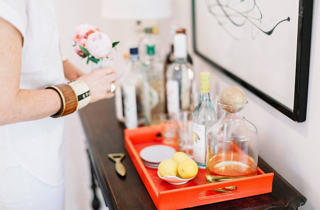 "Gen tends bar in chic white. While the rest of Tennessee might like whiskey, the Sohrs start evenings with prosecco topped with St. Germain, to make it ""sweeter and fresher."""