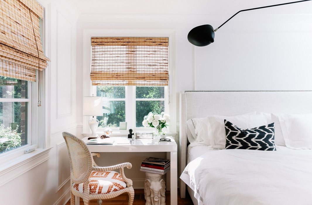 A desk does double-duty as a nightstand. Gen used one of her vintage fabrics—sourced from a secret supply in San Francisco—on the chair's seat.