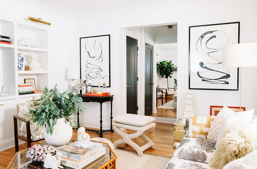 Picked up at the Lincoln Road flea market on Miami Beach, this pair of black-and-white paintings has featured prominently in every one of the couple's homes.