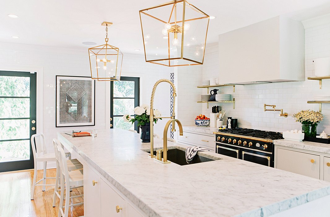 "While they couldn't save the home's original brass hardware, it inspired the new kitchen's hardware. As for the ceiling fixtures, they went big. ""With lighting, nothing is more important than scale. Tiny pendants over a kitchen island kill me,"" says Gen."