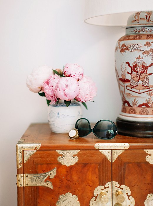 Gen embraces her love of collecting and pattern-on-pattern within her closet.