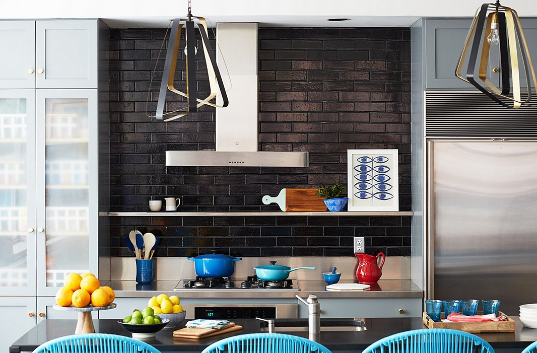 Inspired by the color-blocked wooden necklace, we kept pops of color in set zones in the kitchen.