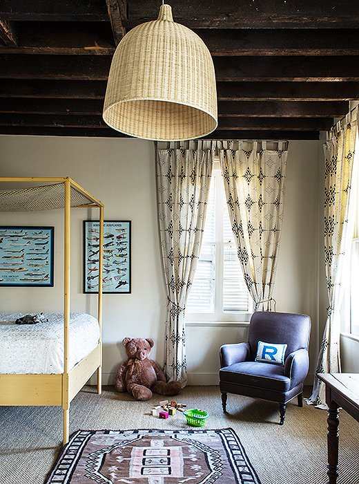 Transform a lonesome bulb into a major statement with a wicker shade. Above, Sara Ruffin Costello did just that in one of her children's bedrooms, mixing tones and textures to create an age-appropriate layered look.