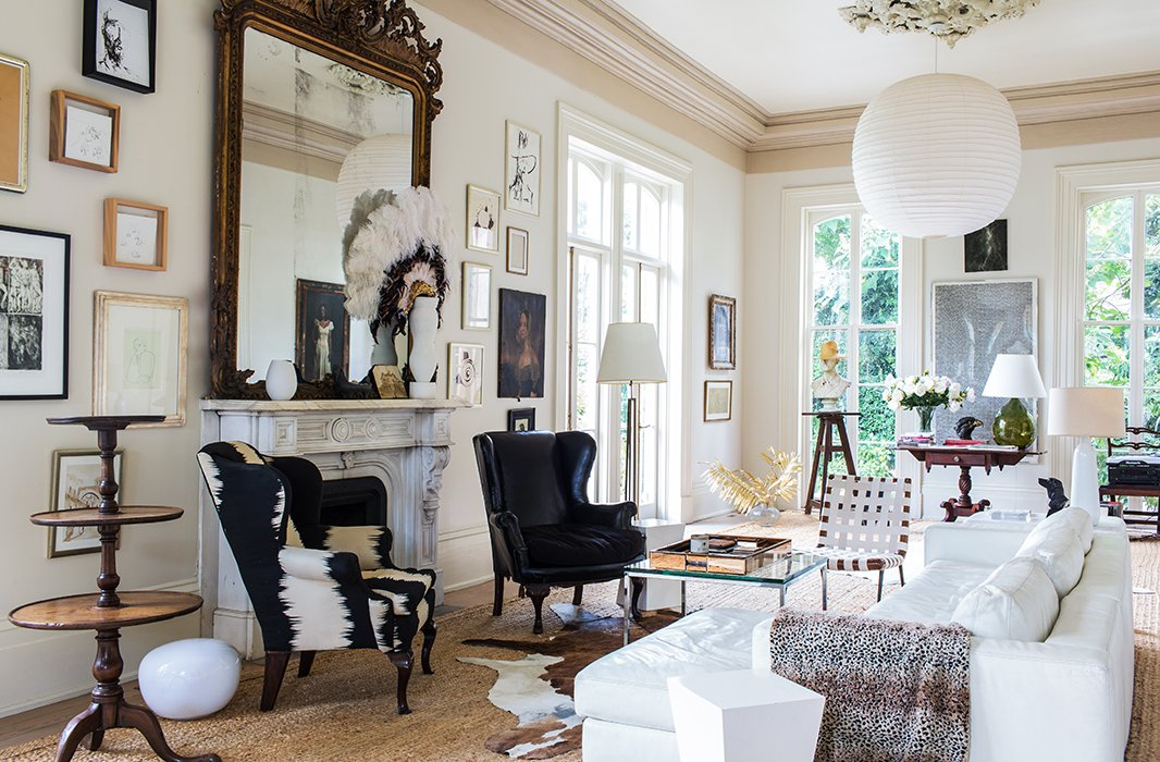 A balance of curvy and straight lines and a restrained palette unify a mix of modern pieces, Early American hand-me-downs from Sara's parents, and two stern wing chairs.
