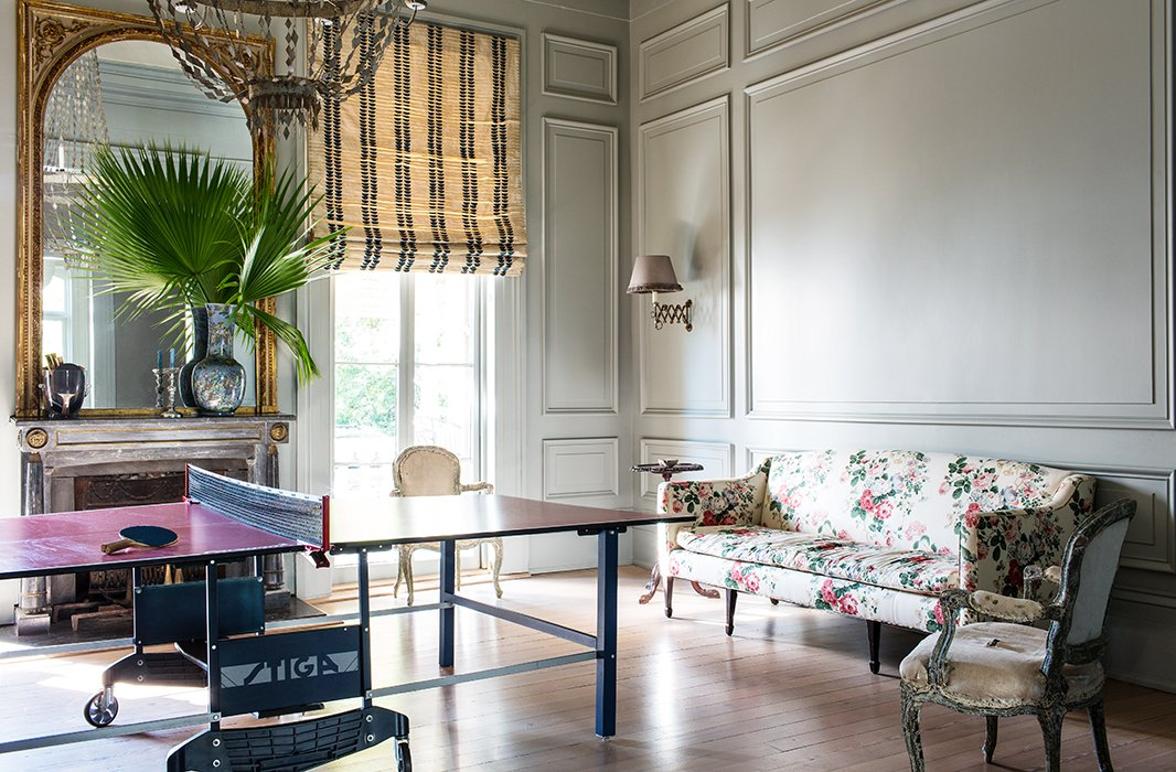 A ping-pong table turns an unused formal dining room into the ultimate hangout space. Chintz and gold complete the high-low mix. Photo by Nicole LaMotte.