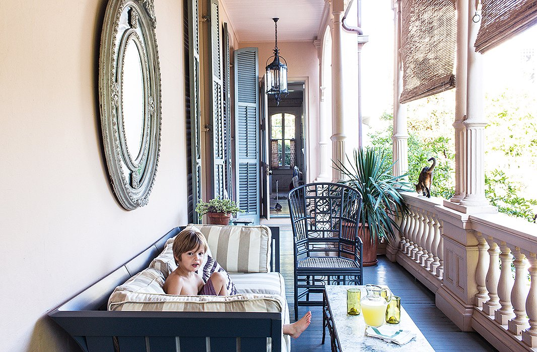 Sara spray-painted the couch and chairs on the side porch off the kitchen a charcoal gray, a subtle contrast to the floor's blue-gray. Roll-down bamboo shades are a necessary defense against the intense New Orleans sun.