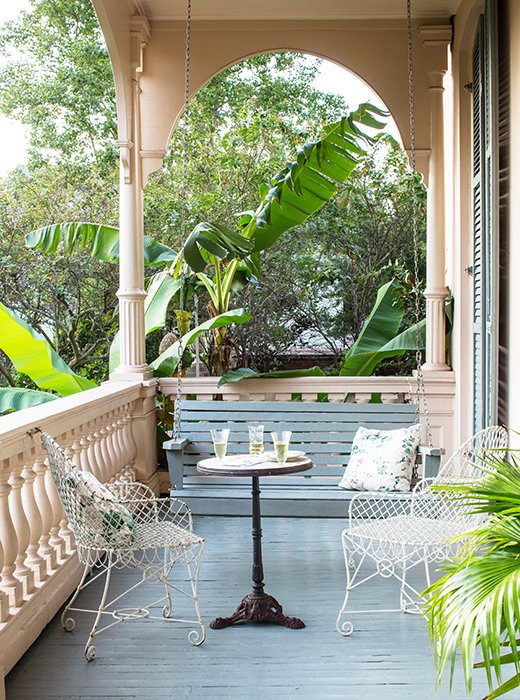 Charming outdoor porch inspiration with swing, metal chairs, and a French table. #porch #outdoor #garden #patio #frenchcountry #summer