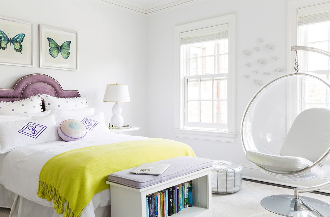 """In the room of one of her daughters, a bubble chair adds a drop of wild style to the pared-downatmosphere. """"She was very minimalist in what she wanted—white walls, no window treatments, no clutter."""""""