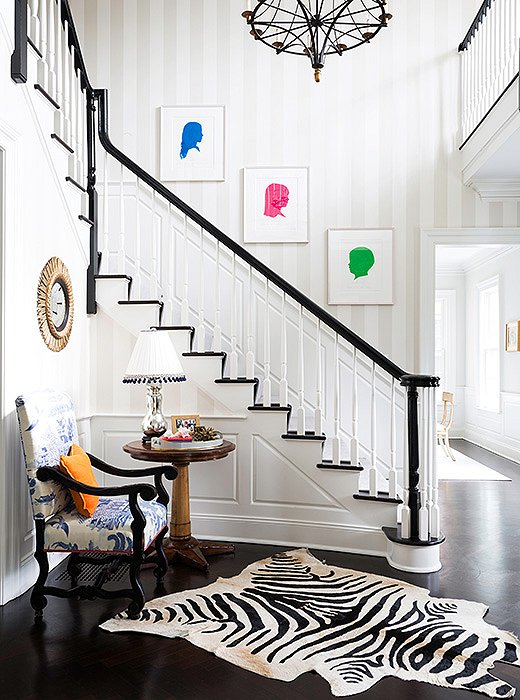 Silhouettes of the couple's children—in neon colors rather than the traditional black-on-white—line the staircase.