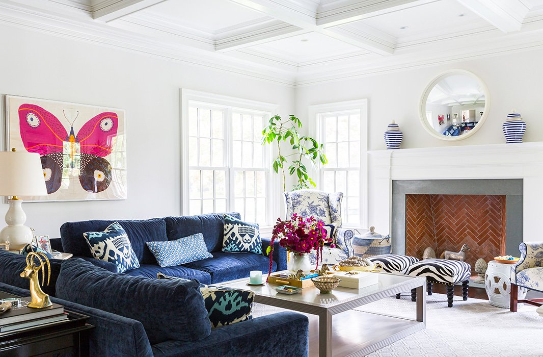 The foundation of the family room is relaxed—note those cushy chenille sofas—but Sue made the atmosphere higher-octane and more fun with pieces like a Natural Curiosities butterfly artwork, a lidded African basket, and a set of zebra stools.