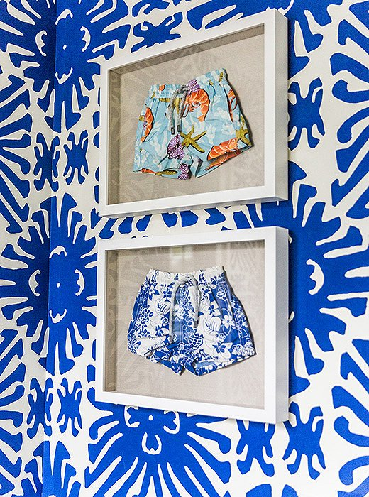 Sue loves to frame anything precious. Case in point? These swim trunks—which her son outgrew—now hang in the wallpapered powder room. When framing scarves, dresses, or other apparel, she suggests having them pressed by a dry cleaner first, and then having a professional framer transfer them to canvas.